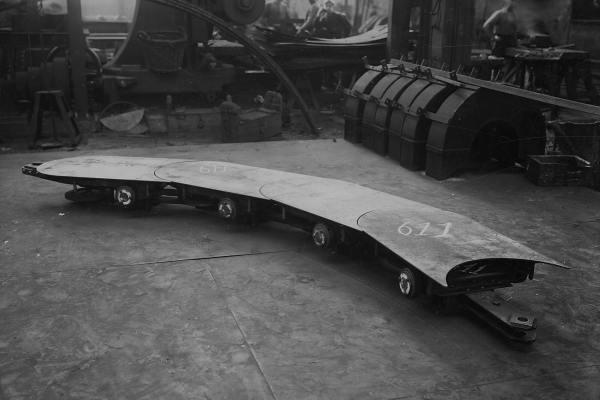 Schakel in een horizontale vatentransportband (Bnr. 611 - 1928).